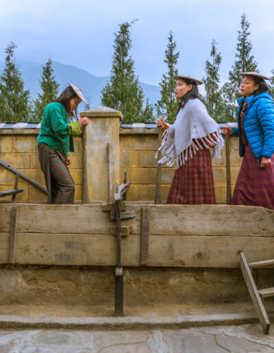Bhutanese-girls-singing-dancing-and-stomping-on-grains-to-make-the-local-brew-Chhang